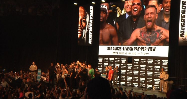 Conor McGregor Amps Up Fans, Goes Wild In Floyd Mayweather's Face At Official Weigh-In